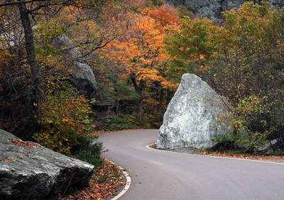 Vermont Fall Leaves and Road Winding Around Boulders